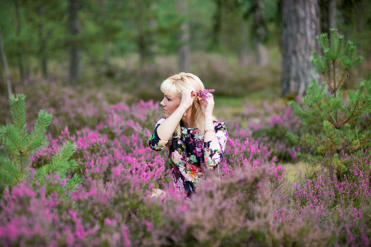beautiful woman in blooming heather field Adult Beauty In Nature Blond Hair Casual Clothing Day Field Flower Flower Head Forest Fragility Freshness Growth Heather Leisure Activity Lifestyles Model Nature One Person Outdoors People Plant Real People Tree Young Adult Young Women