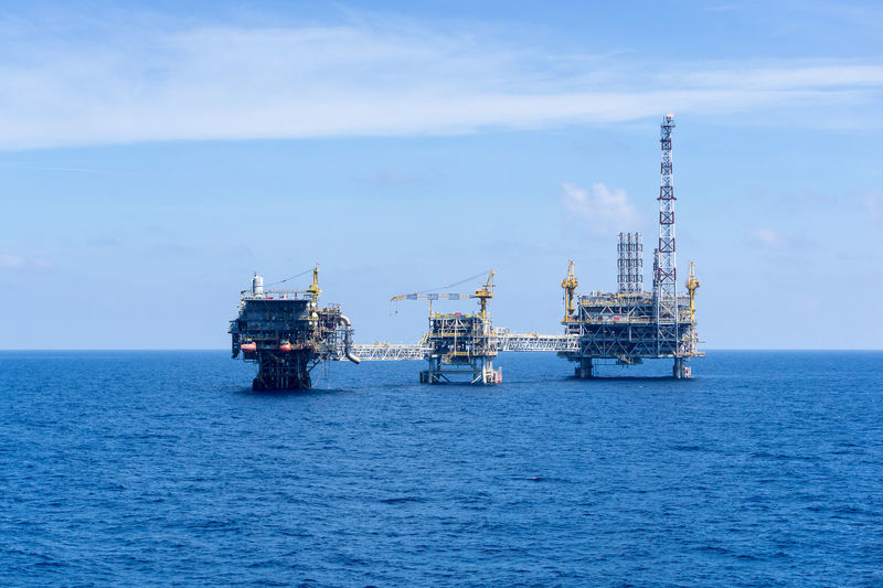 offshore platforms Petrochemical Wave Engineering Bridge Crane Brownfield Offshore Offshore Life Gas Oil Oil And Gas Industry Production Upstream Petroleum Fossil Fuel Oil Rig Oil Field Exploration Drilling Site Cloudy Drilling Rig Offshore Platform Sea Sky Horizon Over Water Crude Oil Natural Gas