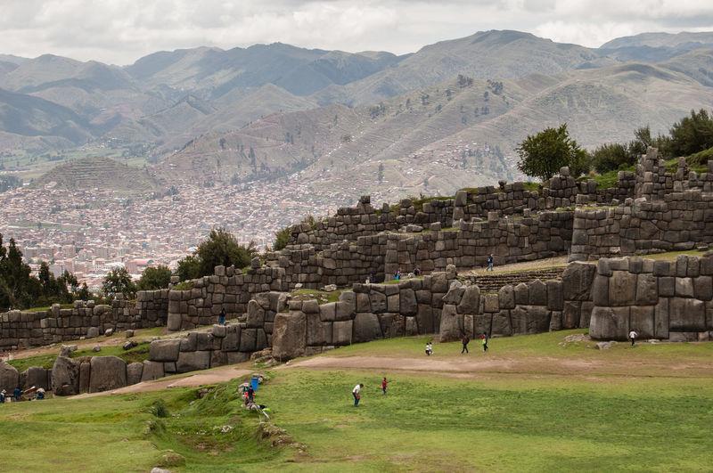 High angle view of tourists at sacsayhuaman