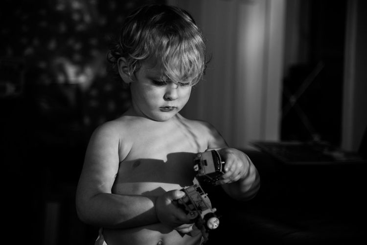 Close-Up Of Boy Playing With Toys