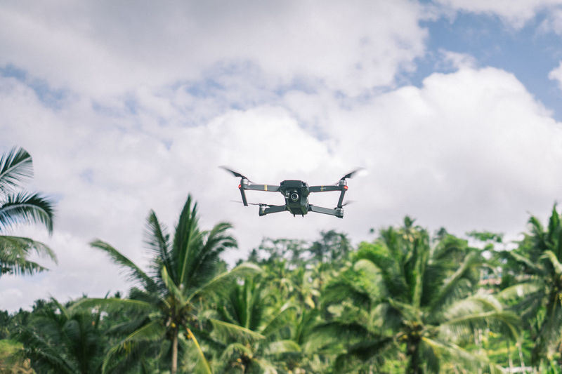DJI Mavic Pro Drone  Air Vehicle Airplane Camera - Photographic Equipment Cloud - Sky Day Drone  Flying Low Angle View Mid-air Modern Motion Nature No People Outdoors Photography Themes Plant Sky Surveillance Technology Transportation Tree
