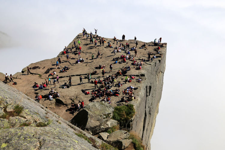 Hoards of tourists from all nations crowd Prekestolen rock at midday on a foggy day, relaxing, posing and lunching. Authentic Moments Skandinavien Scandinavia Rock Formation Stavanger Preikestolen Prekestolen Norway Norwegen Happy People Mountain Range Foggy Mass Tourism Leisure Activity Authentic Authentic Moment Abseits Der Massen Norway🇳🇴 Large Group Of People Group Of People Mixed Age Range Authentic Holiday Posing For The Camera TourismFoggy Day