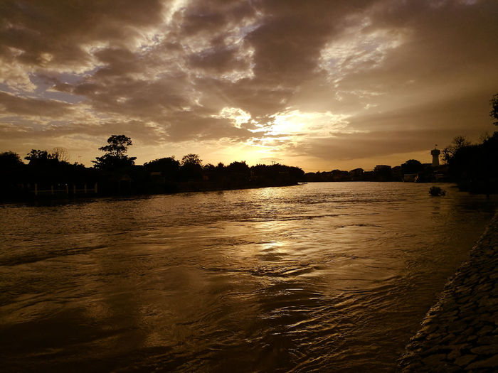Sunset and shadow sun on the river Nature Sunlight Tourism Reflection Landscape Nature Cloud - Sky Tranquility No People Scenics Beauty In Nature Day Sunset Lake Water Tree Ayutthaya Thailand Sky Thailand🇹🇭 Pictures Riverside Outdoors Beauty In Nature Sunset_collection Sunrise_sunsets_aroundworld