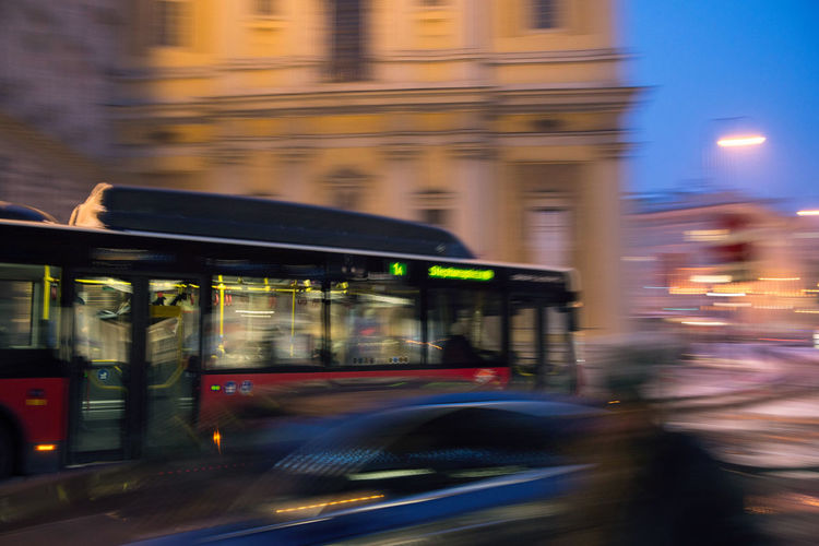 bus moving fast in the night city in motion blur , evening Blurred Motion Motion Speed Mode Of Transportation Illuminated Transportation Night City Architecture Long Exposure Land Vehicle Street on the move No People Building Exterior Travel Outdoors Public Transportation Built Structure Road