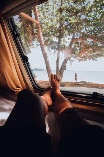 Low section of woman relaxing in motor home