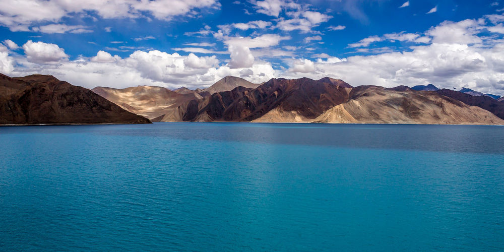Pangong Tso at 4,350m is one of the many beautiful lakes in Leh. LakePangongBeauty In Nature Blue Cloud Cloud - Sky Day Idyllic Laddak Landscape Landscape_Collection Landscape_photography Leh Mountain Mountain Range Nature Non-urban Scene Remote Rippled Scenics Sky Tranquil Scene Tranquility Water Colour Of Life
