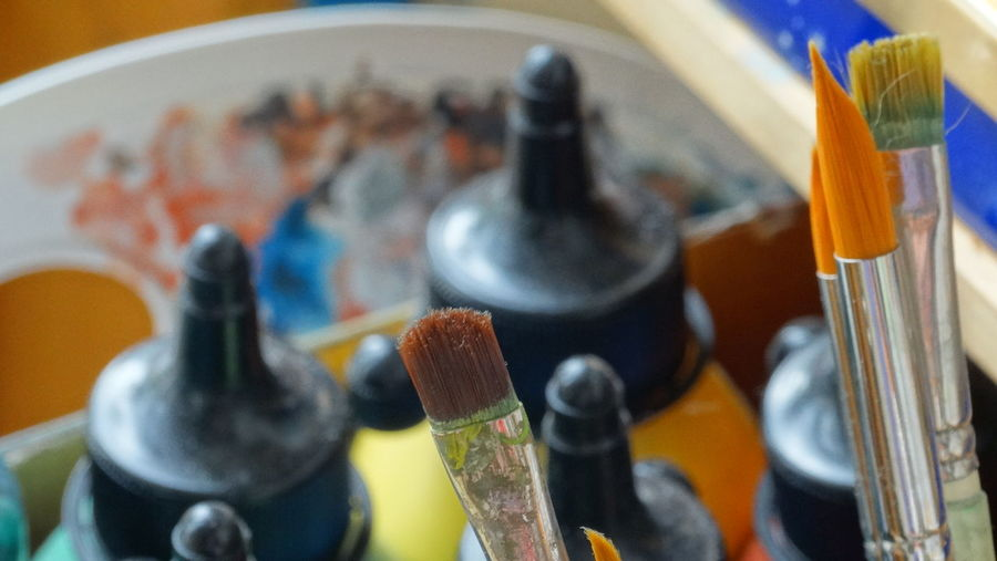 High Angle View Of Paintbrushes With Watercolor Paints