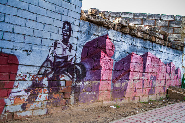 Soweto street art near Vilakazi Street Street Photography The Past Brick Wall Art And Craft Day Mural Outdoors History Street Art Creativity No People Human Representation Building Exterior Brick Wall - Building Feature Wall Graffiti Soweto South Africa Representation Hector Pieterson