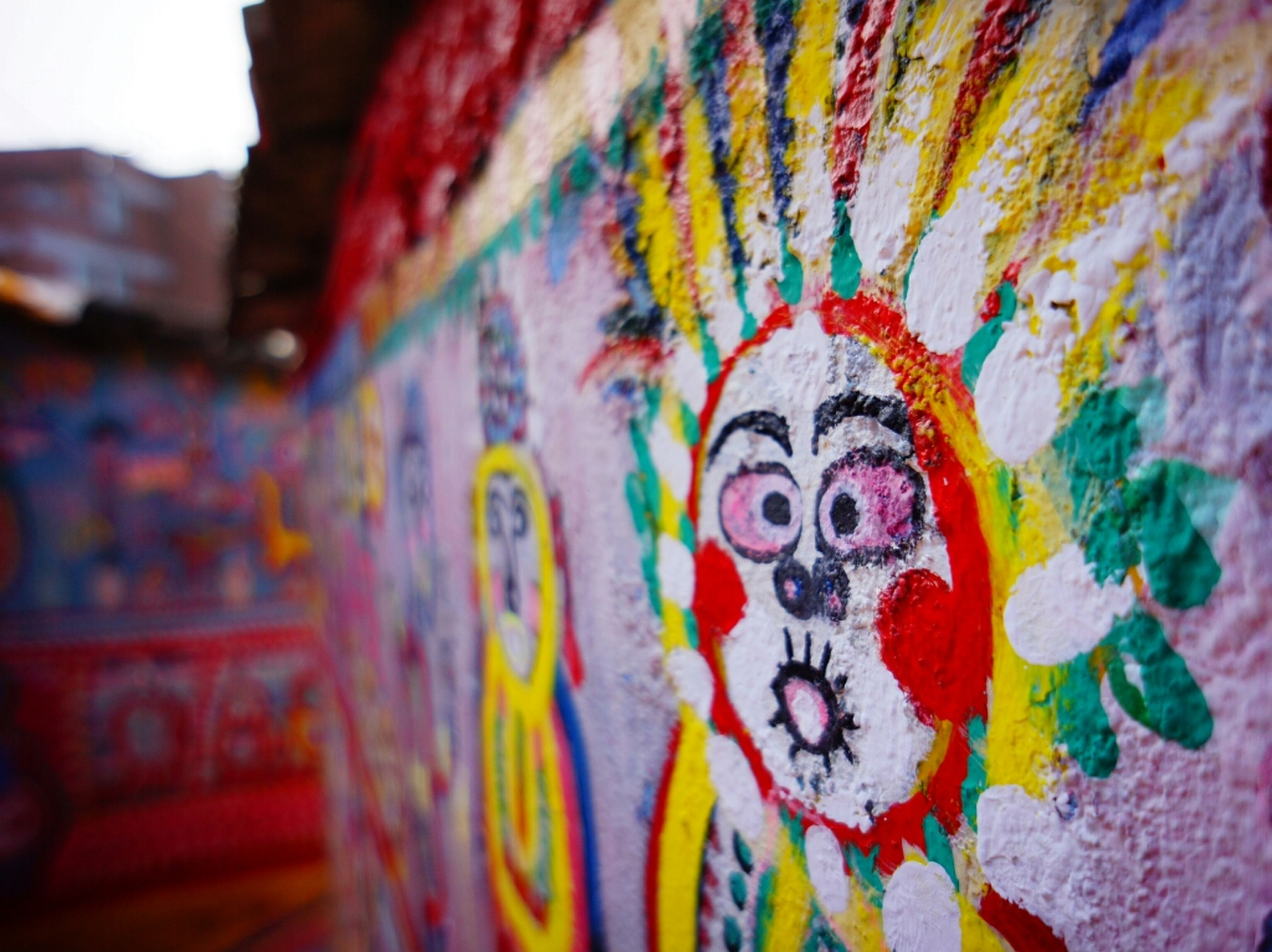 art, creativity, art and craft, graffiti, multi colored, indoors, wall - building feature, built structure, architecture, design, close-up, pattern, human representation, wall, painting, no people, floral pattern, textured, text, day