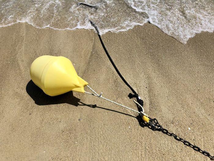 High angle view of yellow umbrella on beach