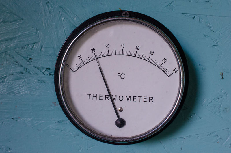 Close-up of thermometer on machinery