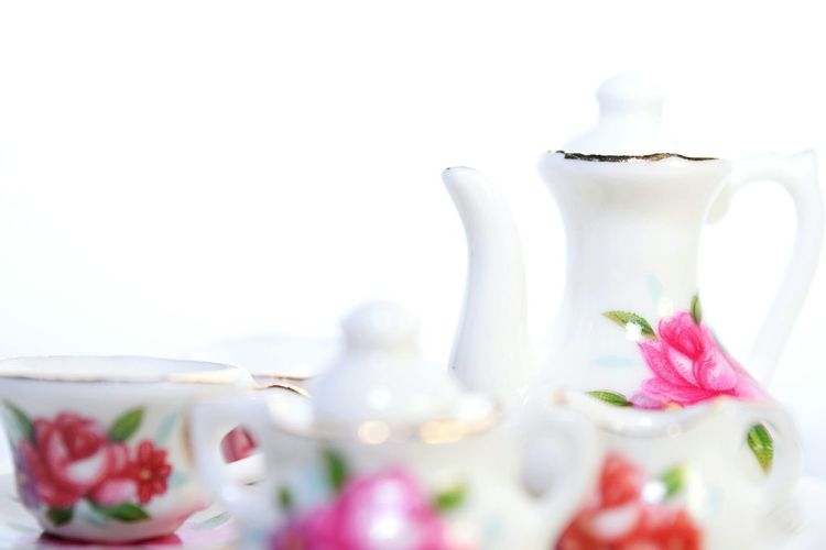 Close-up of crockery against white background