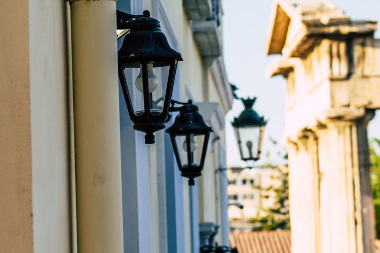 Low angle view of street light mounted on wall