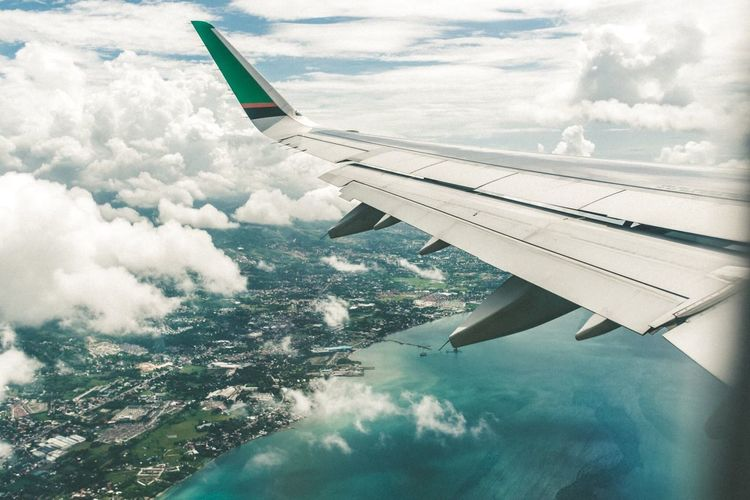 Aerial view of airplane wing over landscape