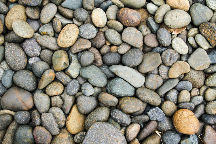 Black pebble stone background Nature Textured  Background Beach Black Pebble River Stone