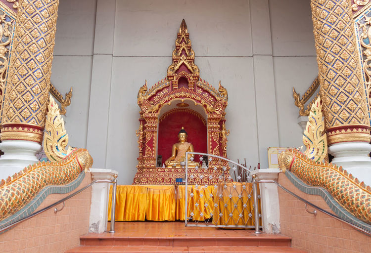 Statue of temple in building