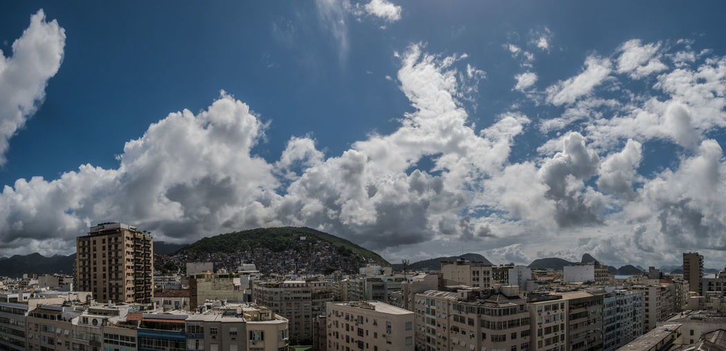 Aerial view of townscape against cloudy sky