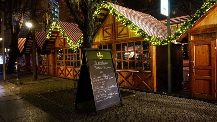Berliner Ansichten Berliner Ansichten Berlin Christmas Market Christmas Decoration Night Illuminated Built Structure Architecture Building Exterior Communication Street City Text No People Lighting Equipment Building Western Script Outdoors Decoration Sign Entrance