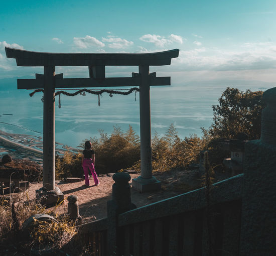 Shootermag Japan Exploring One Person EyeEm Best Shots EyeEm Sky Real People Architecture Cloud - Sky Nature Built Structure Women Lifestyles Standing Leisure Activity Day Full Length Adult Railing Casual Clothing Outdoors Rear View Building Exterior Looking At View