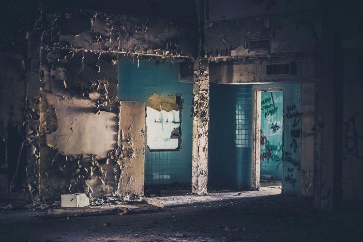 Peeling off wall of abandoned house
