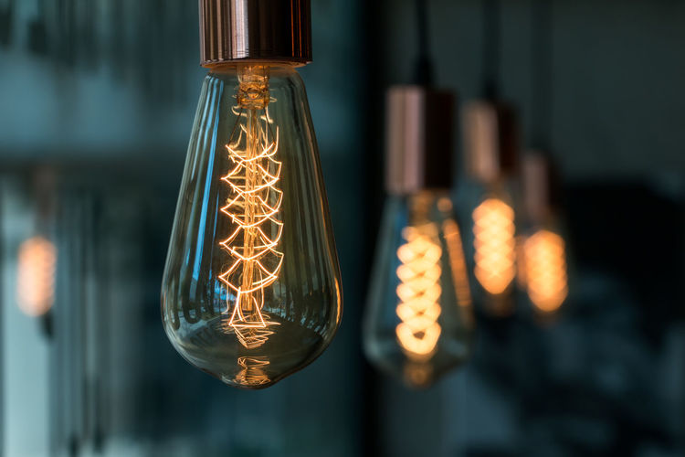 Bulb Close-up Electric Lamp Electric Light Electrical Equipment Electricity  Filament Focus On Foreground Fuel And Power Generation Glass - Material Glowing Hanging Illuminated Indoors  Light Light - Natural Phenomenon Light Bulb Lighting Equipment No People Technology Transparent