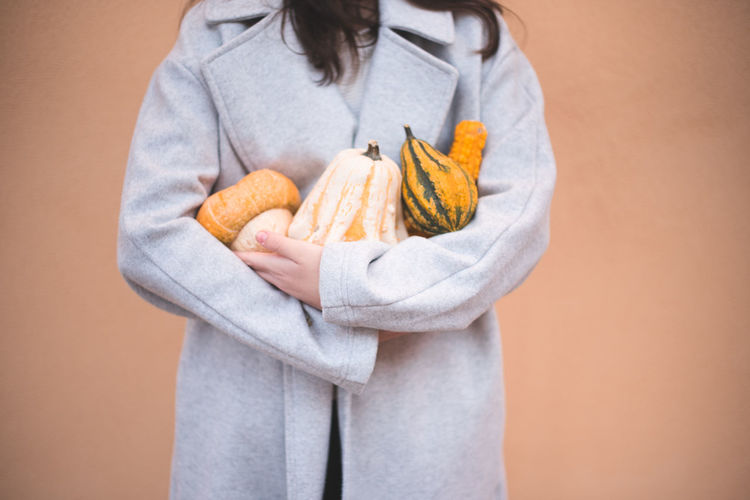 Autumn Mood Holding Colored Background One Person Food And Drink Studio Shot Food Indoors  Standing Bathrobe Wellbeing Adult Healthy Eating Snack Women Healthy Lifestyle Robe Freshness Casual Clothing Midsection Teenager Dieting