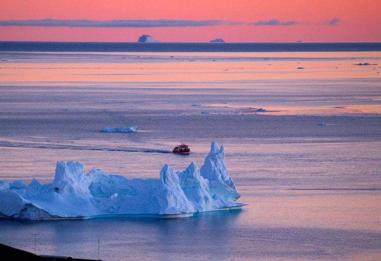High Angle View Of Icebergs In Sea During Sunset