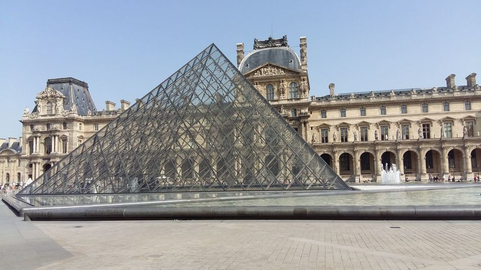 Architecture History Travel Destinations Built Structure Sky Outdoors Pyramid No People Day City Pyramide Du Louvre Louvre EyeEmNewHere Water Water Jet Tourism