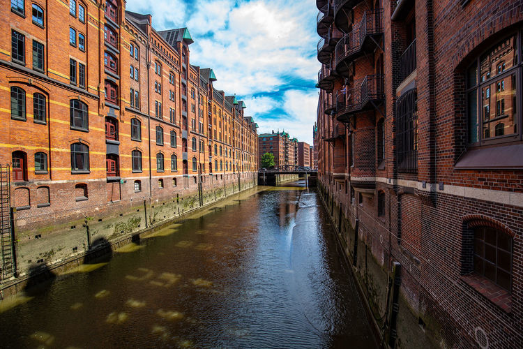 Hamburg Speicherstadt Hamburg Architecture Bridge Building Building Exterior Built Structure Canal City Cloud - Sky Day Incidental People Nature Outdoors Reflection Residential District Sky Speicherstadt Transportation Water Waterfront Wet