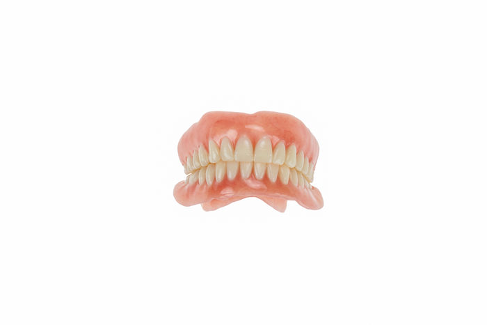 Upper and lower dentures on white background. Artificial Close-up Dental Health Dentures No People Replacement Studio Shot Technology Teeth White Background
