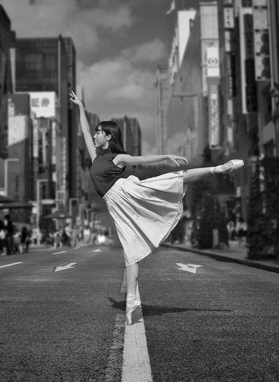 Dancing in the Tokyo streets Dance Japan Outdoors Tokyo Ballerina Ballet Dancer City Building Exterior Street One Person Architecture Built Structure Road Day Real People Transportation Focus On Foreground Lifestyles Women Full Length Outdoors Nature Adult City Life Leisure Activity Plastic Bag