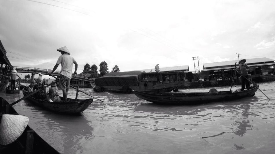 commerce in its primitive form Commerce Traveling Boat People Together People Water Market Floating Market Monochrome Blackandwhite