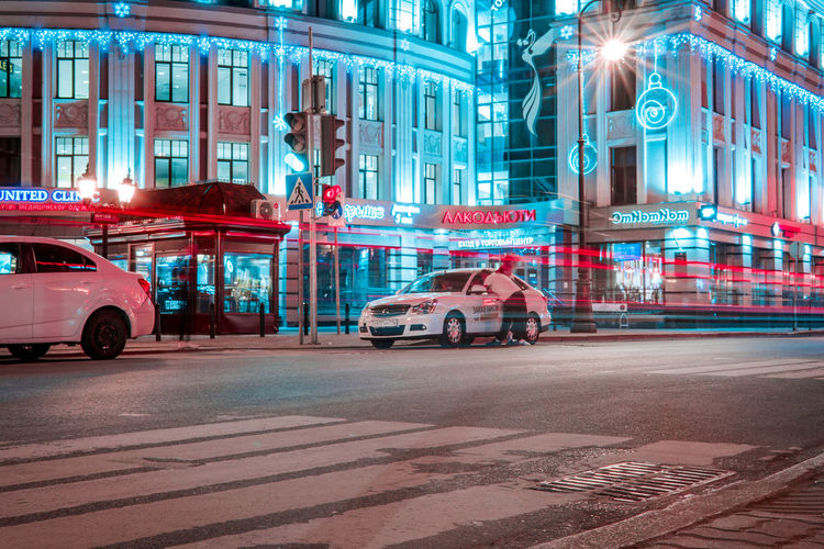 Mode Of Transportation City Transportation Car Street Motor Vehicle Building Exterior Architecture Illuminated Built Structure Night Land Vehicle Road City Life Motion Incidental People Red City Street on the move Digital Composite Nightlife