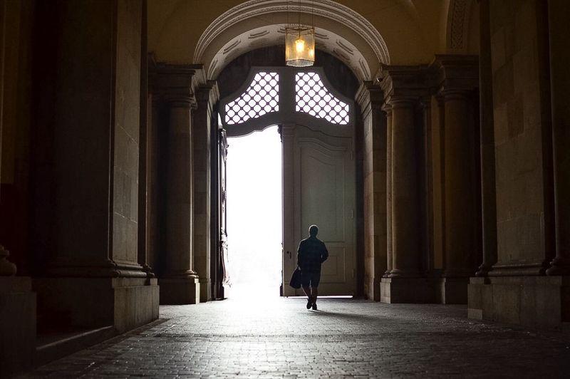 Full length of woman walking in corridor