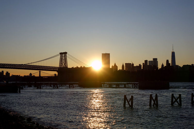 View of bridge in city at sunset