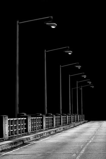 Empty road against sky at night