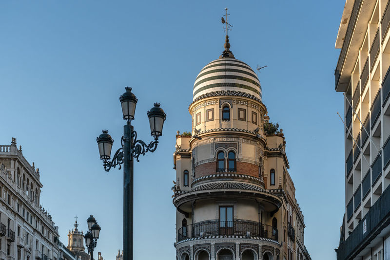 towards the sky architecture, Sevilla daytime Architecture Blue Sky Building And Sky Buildings Daytime Sevilla SPAIN Street Light Symmetry Beautiful Towards The Sky Blue Low Angle View Seville Seville,spain