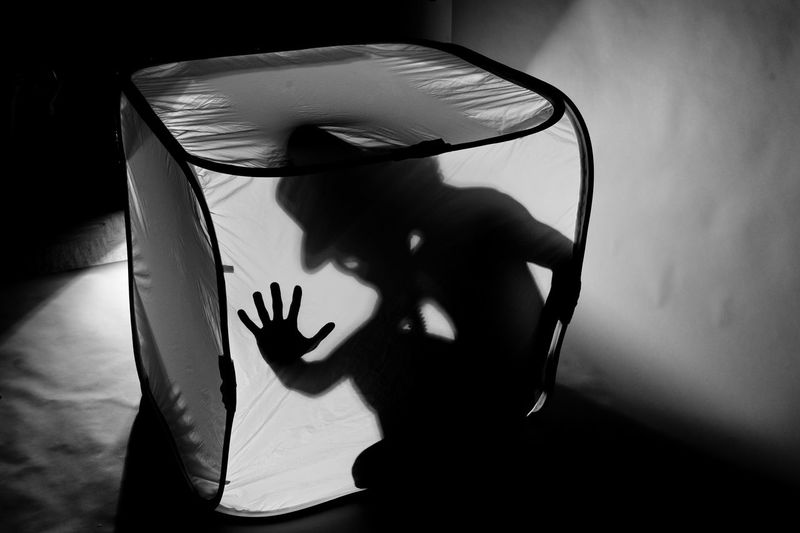 Man trapped in tent against light