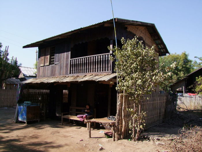Traditional Wooden House in Pakokku Village Balcony Blue Sky Building Exterior Clear Sky Composition Myanmar No People Outdoor Photography Pakokku Sunlight And Shadows Teak House Teak Wood Traditional House Traditional Housing Travel Destination Tree Wooden Building Wooden House