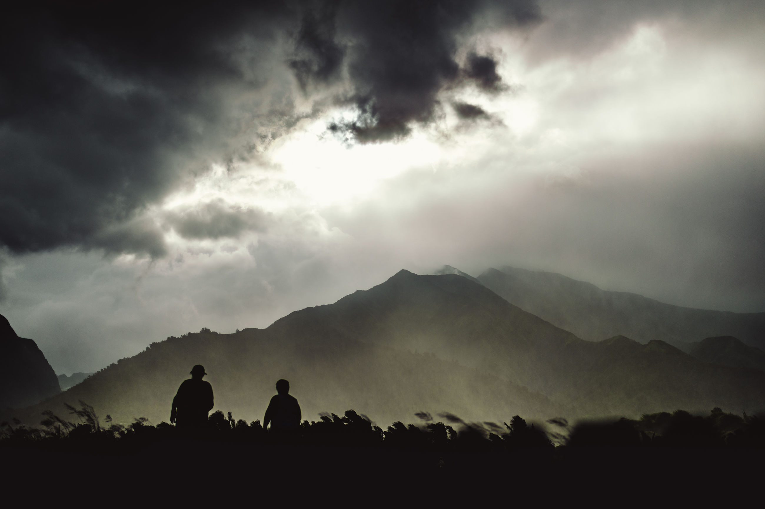 mountain, silhouette, tranquil scene, scenics, mountain range, sky, tranquility, beauty in nature, landscape, cloud - sky, men, nature, lifestyles, leisure activity, non-urban scene, person, idyllic, weather, cloudy
