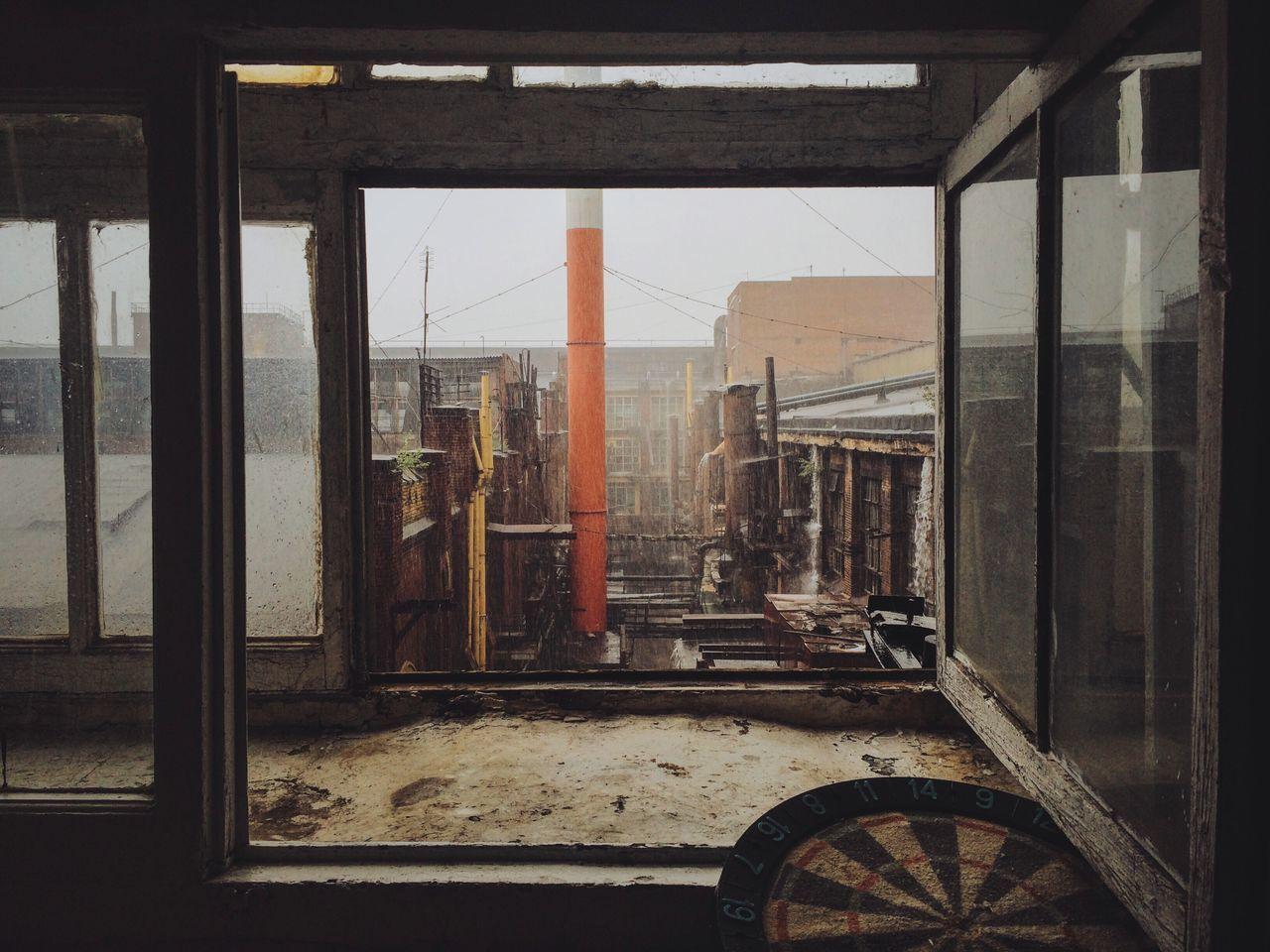 VIEW OF CITY THROUGH WINDOW