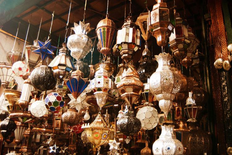 Low angle view of illuminated lanterns hanging at market stall