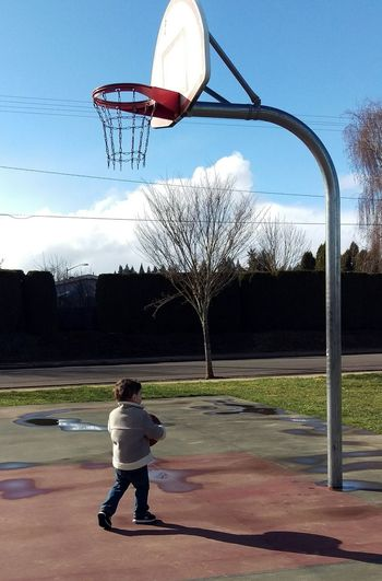 Full Length Outdoors Clear Sky Sky Leisure Activity One Person Sport People Childhood Basketball Hoop Day Court