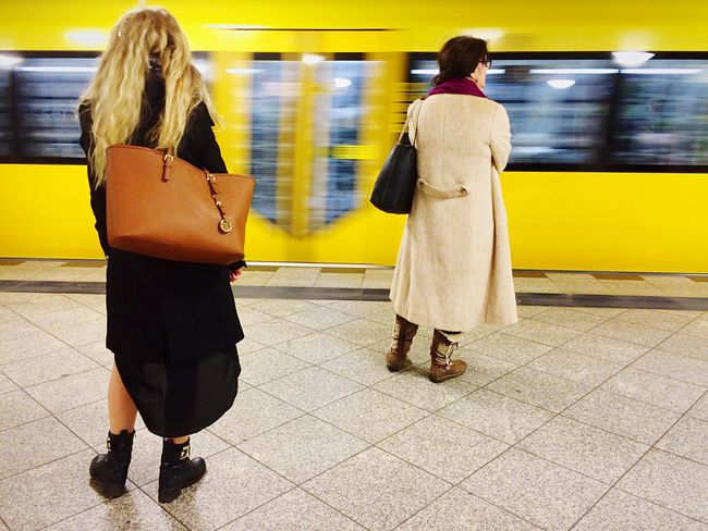 Women Waiting for a Bvg Train at Train Station