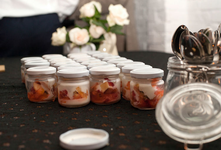 Fruit salad in small jars kept on table