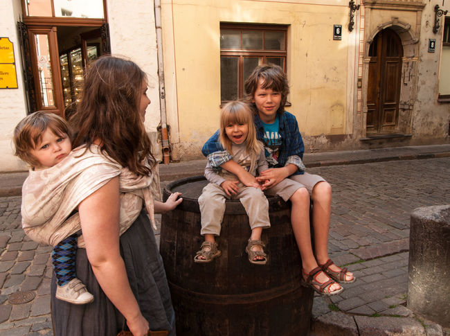 Sittin' on the barrel in the Old Town of Riga Baby Baby Sling Baby Wrap Babywearing Bonding Childhood Children Family Friendship Happiness Leisure Activity Lifestyle Looking At Camera Love Maternity Mom Mother And Son Motherhood Old Town Outdoors Parenting Riga Sling Smiling Woman Neighborhood Map Live For The Story