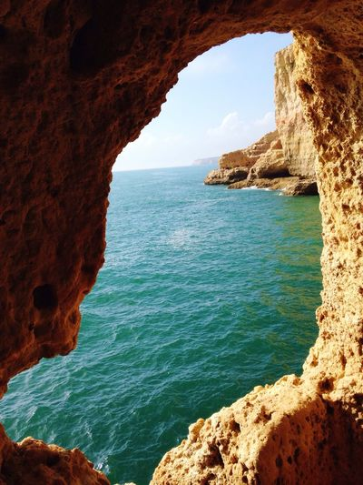 High angle view of sea seen from rocky cliff
