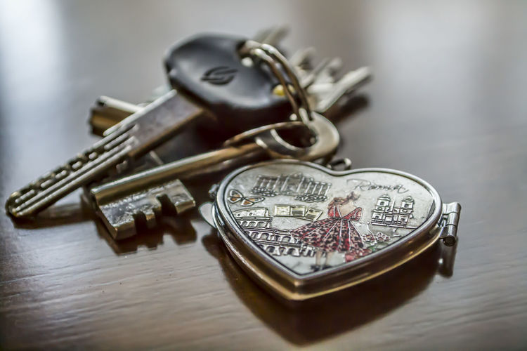 Close-up of heart shaped key ring on table