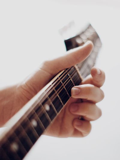 Mandolin Strings Mandolin Music Human Hand Hand Human Body Part One Person Musical Instrument Music Indoors  String Instrument Finger Human Finger Musical Equipment Playing White Background Arts Culture And Entertainment