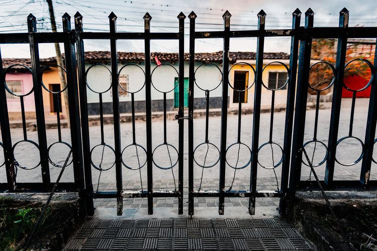 Houses seen through closed gate